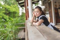 Девушка горничной японского стиля милая Стоковое Изображение