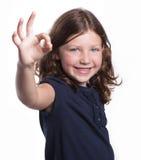 девушка дает k меньший знак o Стоковое Изображение