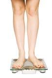 девушка ее измеряя вес Стоковые Фотографии RF