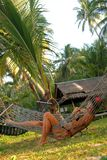 Девушка лежит в гамаке Стоковая Фотография RF