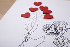 Девушка держа баллон сердца форменный Стоковые Фото