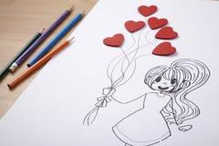 Девушка держа баллон сердца форменный Стоковая Фотография