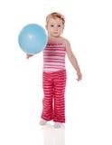 Девушка держа воздушный шар стоковые изображения