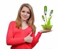 Девушка держа в шариках энергии eco руки Стоковая Фотография RF