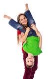 Девушка держа его брата вверх ногами Стоковые Фото