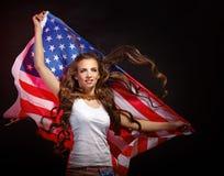 Девушка держа развевать флага США Стоковое фото RF