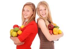 Девушка 2 держа свежие фрукты Стоковое Изображение