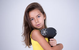 Девушка держа фен для волос Стоковое фото RF