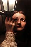Девушка держа фонарик Стоковые Фото