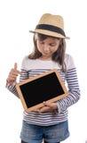 Девушка держа шифер на белой предпосылке стоковые фото