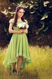 Девушка лета Fairy с букетом цветка Стоковые Изображения