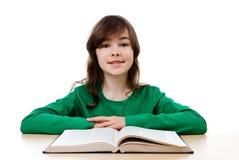 Девушка делая домашнюю работу Стоковые Изображения