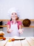 Девушка делая хлеб Стоковые Фото