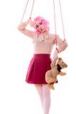 Девушка женщины стилизованная как марионетка марионетки на строке Стоковое Фото
