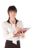девушка завертывает детенышей в бумагу таблетки Стоковое Изображение