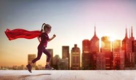 Девушка играет супергероя Стоковая Фотография