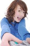 девушка играя подростковую видеоигру Стоковые Изображения RF