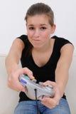 девушка играя playstation подростковое Стоковое Изображение RF