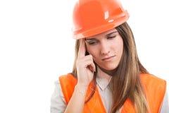 Девушка или архитектор инженера имея мигрень головной боли Стоковая Фотография