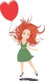 Девушка имбиря в зеленом платье с в форме сердц воздушным шаром Стоковые Изображения