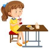 Девушка имея обед на таблице иллюстрация штока
