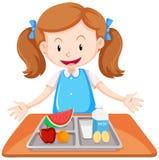 Девушка имея обед на таблице бесплатная иллюстрация
