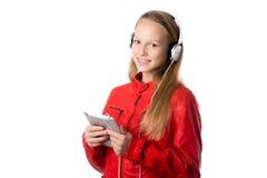 Девушка используя таблетку Стоковые Фото