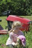 Девушка и ее коза младенца Стоковые Изображения RF