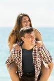 Девушка и ее усмехаться парня Стоковая Фотография