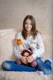 Девушка и игрушки стоковое фото