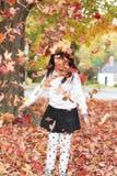 Девушка и листва Стоковое Изображение RF