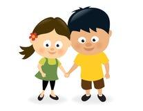 Девушка и мальчик держа руки Стоковые Изображения