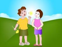 Девушка и мальчик с одуванчиками Стоковое фото RF