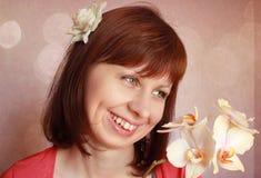 Девушка и орхидея Стоковое Изображение RF