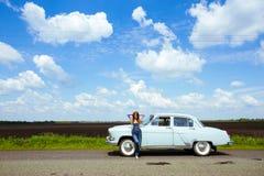 Девушка и ретро автомобиль Стоковое фото RF