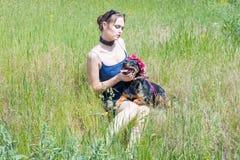 Девушка и собака Стоковое Изображение