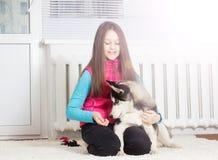 Девушка и собака стоковое фото