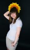 Девушка и солнцецвет Стоковое фото RF