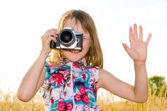 девушка камеры меньший принимать slr изображения Стоковое фото RF