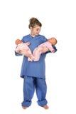 девушка кукол доктора младенца держа немногую твиновской Стоковое Изображение RF