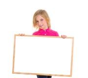 Девушка малыша ребенка счастливая держа пустое copyspace классн классного Стоковое Фото