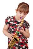 девушка меньший играть нот Стоковое Изображение