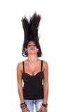 Девушка мечет ее волосы Стоковая Фотография