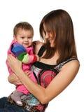 девушка младенца жизнерадостная ее мать Стоковая Фотография