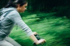 Девушка на велосипеде в пуще Стоковое фото RF