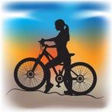 Девушка на велосипеде Стоковая Фотография