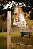 Девушка на загородке Стоковая Фотография RF