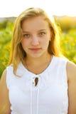 Девушка на заходе солнца Стоковое Фото