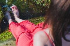 Девушка на камне Стоковое Фото