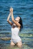 Девушка на море стоковые изображения